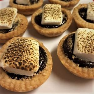 Mini smores tarts with chocolate ganache filling and toasted marshmallow topping