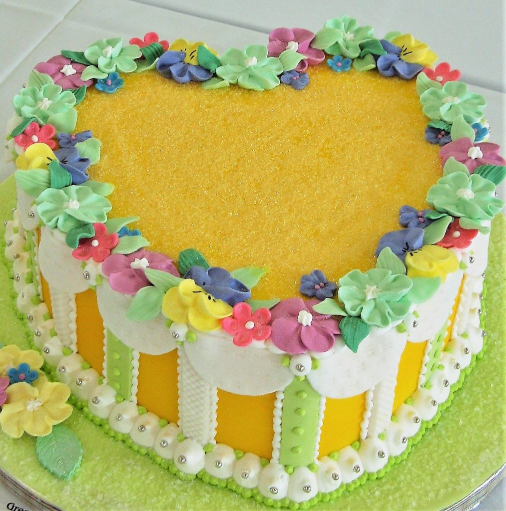 heart cake with royal icing flowers