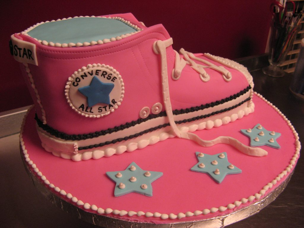 PInk replica of a converse shoe made into cake