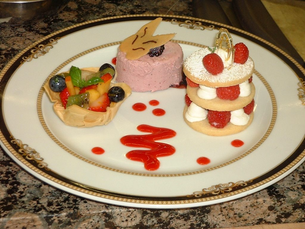 Trio of desserts with fruit plate with sauces
