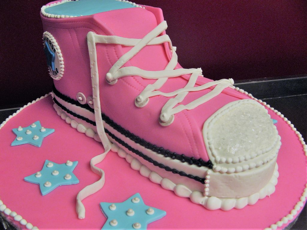 Pink converse shoe replica cake with white laces
