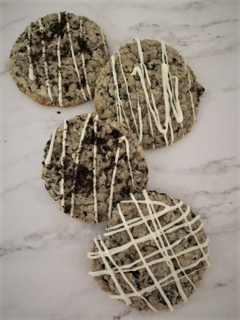 Cream Cheese Cookies loaded with Oreo's and a vanilla drizzle on top
