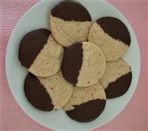 Cream Cheese Cookies on a platter made with Strawberry Jam dipped in Chocolate
