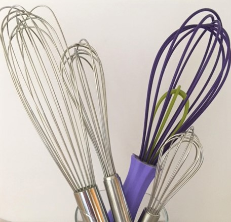 collection of kitchen whisks