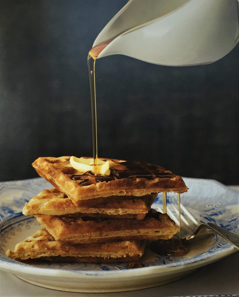 waffles on a plate with syrup