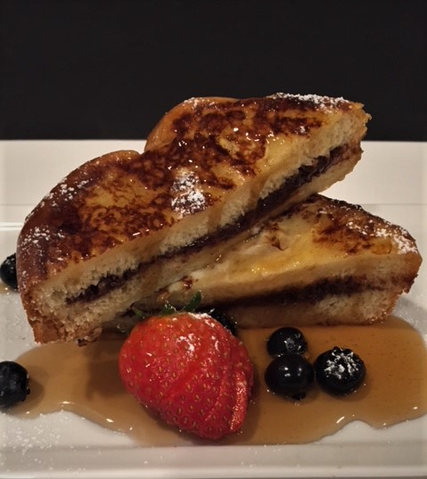 Chocolate Ganache French Toast with syrup and fresh berries