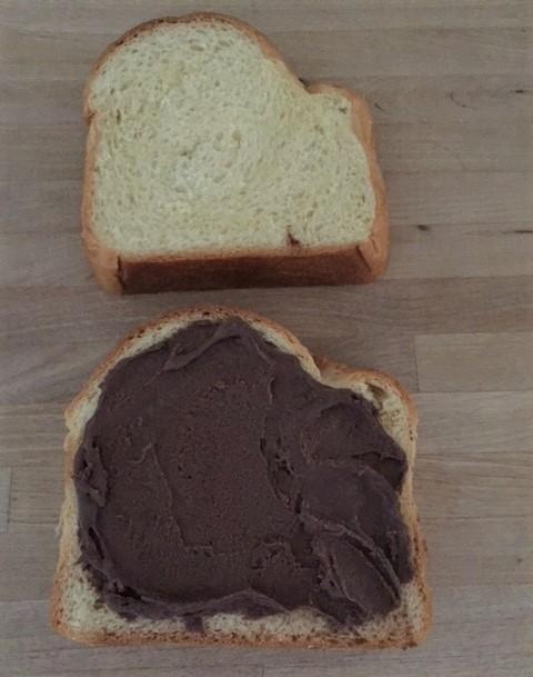 Two pieces of brioche with chocolate ganache