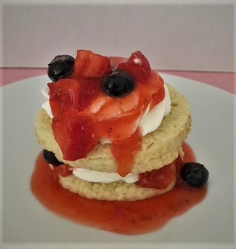 layering mixed berry shortcake dessert