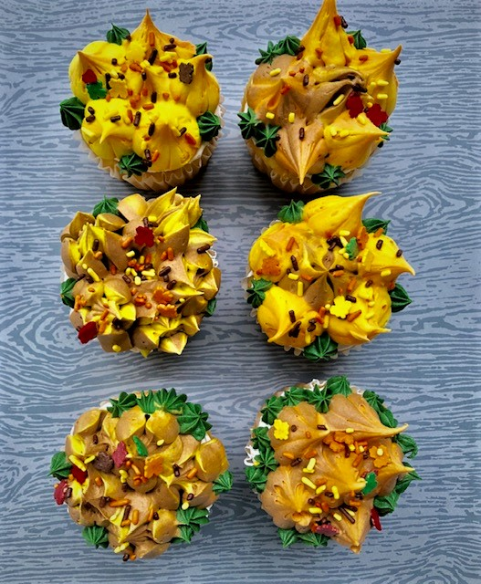 chocolate cupcakes decorated with a swirl of autumn colors