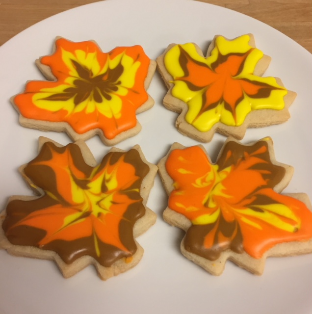 Fall leaf cookies decorated in autumn colors