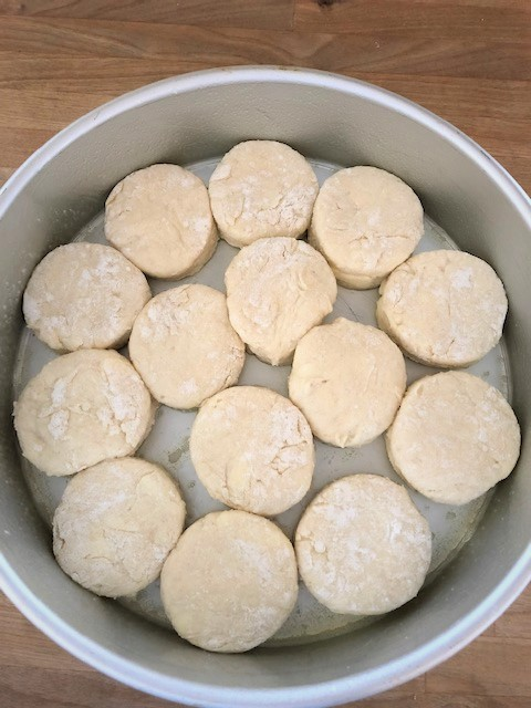 placing biscuits in a baking pan