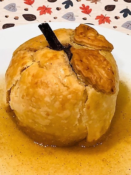 baked apple dumpling with cider sauce