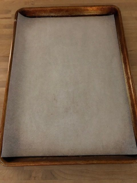 greased baking sheet with parchment paper