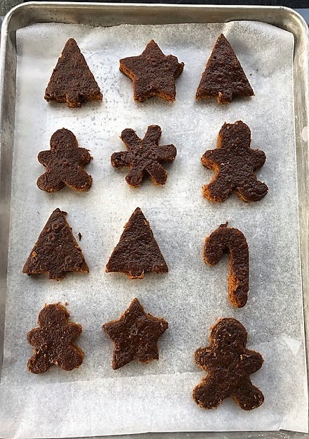 gingerbread cake pieces cut with cookie cutters