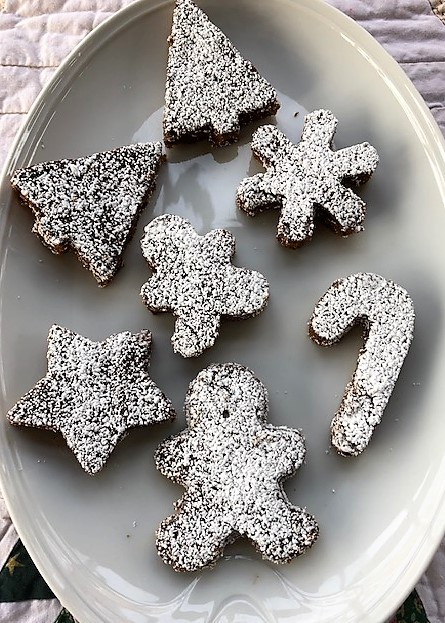 gingerbread cake pieces dusted with powdered sugar served on a platter