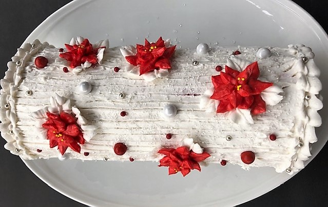 candy cane yule log on a plate