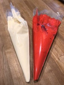 white and red batter in piping bags