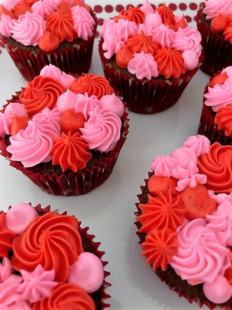 chocolate valentines day cupcakes with surprise red center with red and pink icing