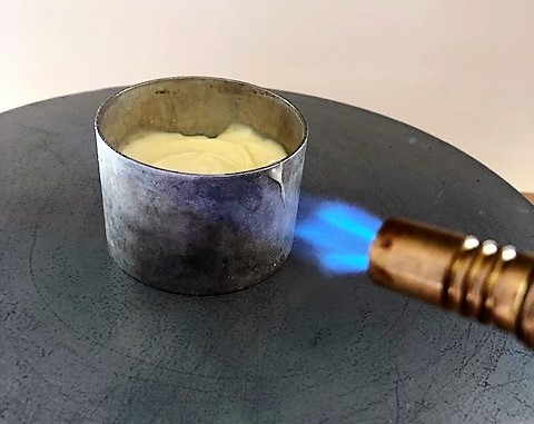 removing mousee desserts from ring molds with kitchen torch