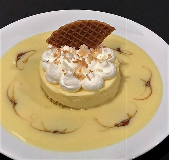 White Chocolate Mousse dessert with French Vanilla Creme Anglaise on a plate