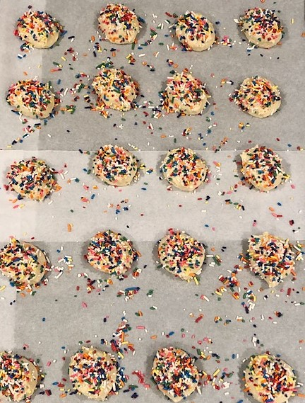 whoopie pie dough with sprinkles before baking on a sheet pan
