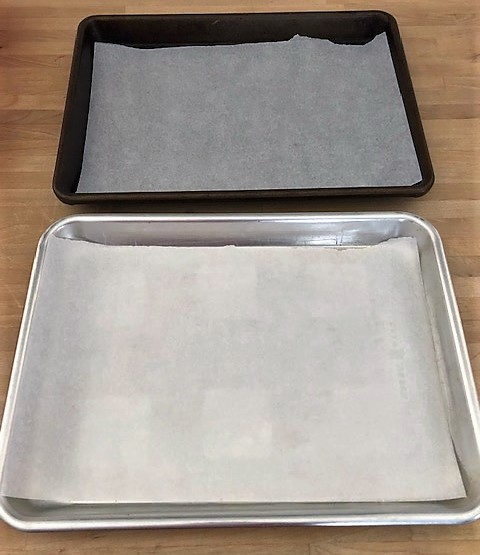 Two prepared 1/4 baking sheets