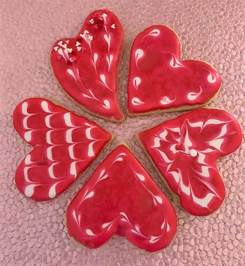 red valentine heart cookies decorated