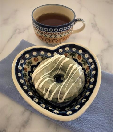 blueberry acai donut and tea on the table