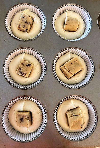 vanilla cupcakes with a cookie dough in the center