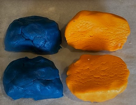 orange and blue dough divided into 4 sections