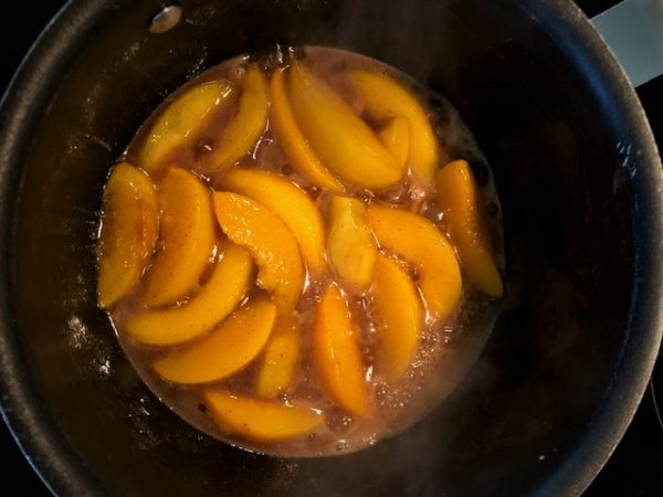 cooking peach cobbler filling