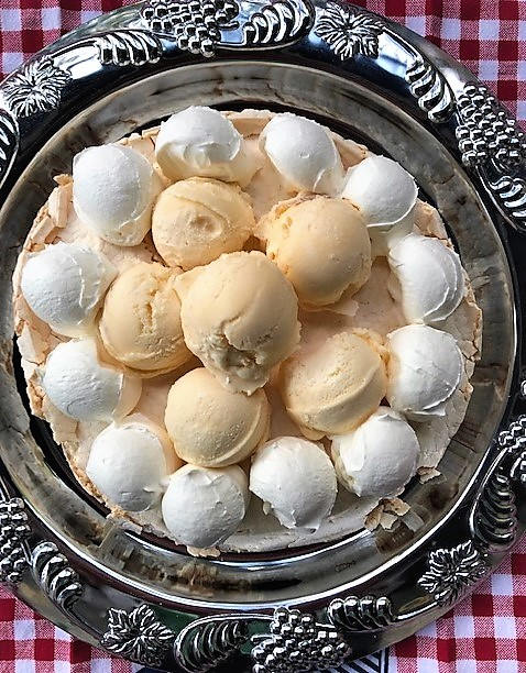 pavlova with cream and ice cream