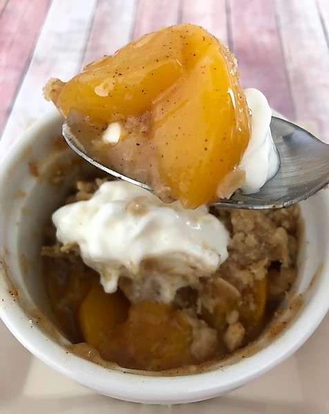 peach cobbler on a spoon