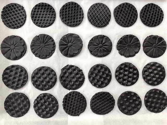 Oreo cookie dough stamped and put on baking tray