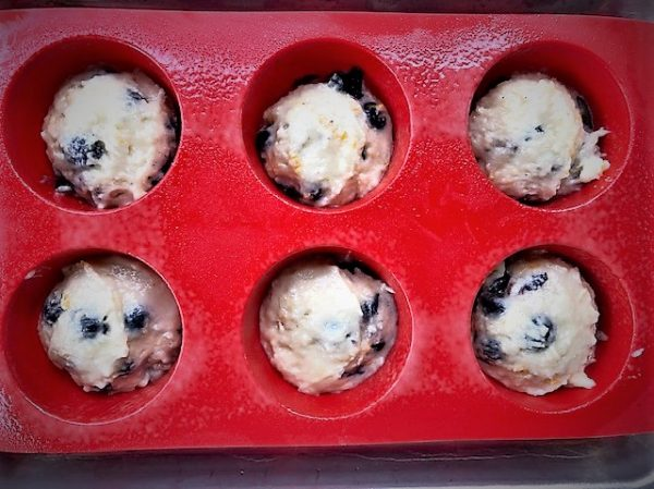 Berry Jammer Muffins scooped into a baking pan