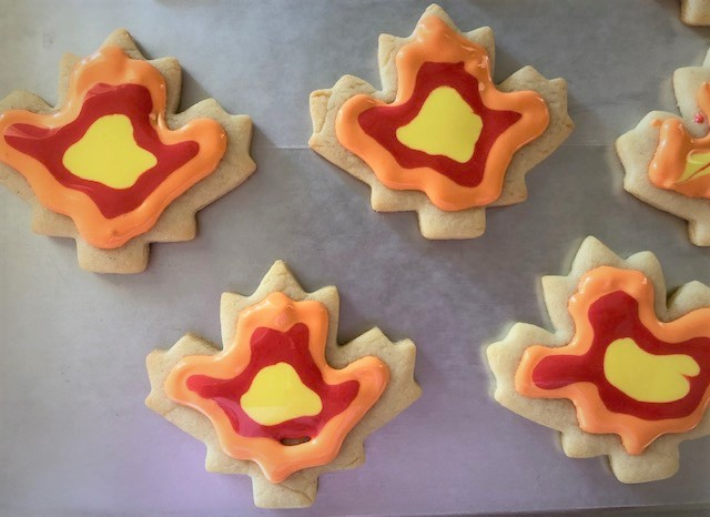 fall leaf triple colored cookies being decorated