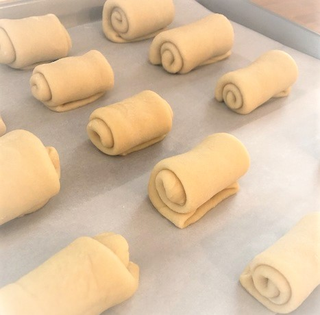 risen rolls ready for the oven