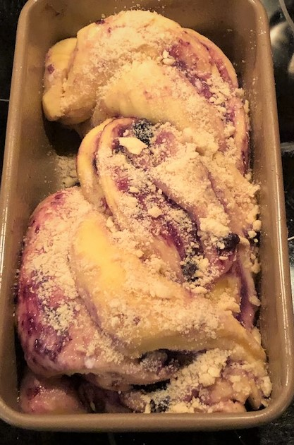 rolled dough with jam in a bread pan