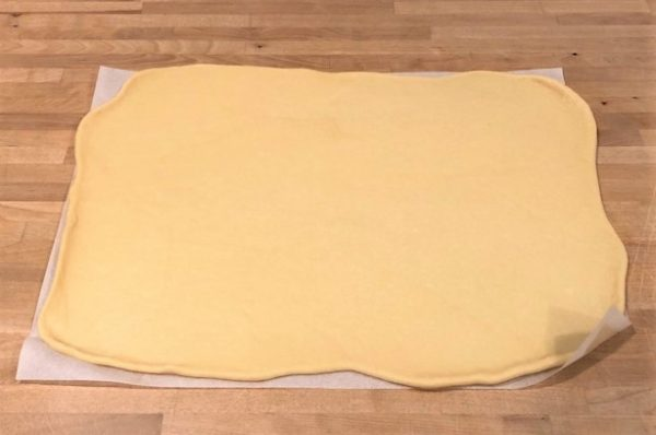 rolled dough onto a piece of parchment paper