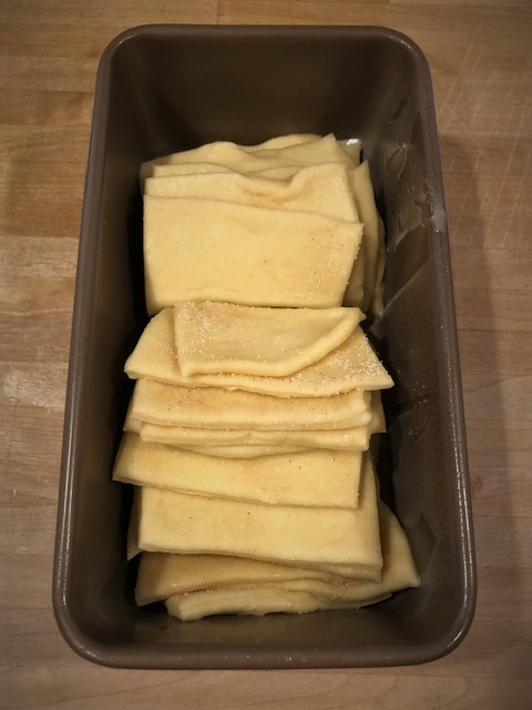 placing pull apart dough in pan