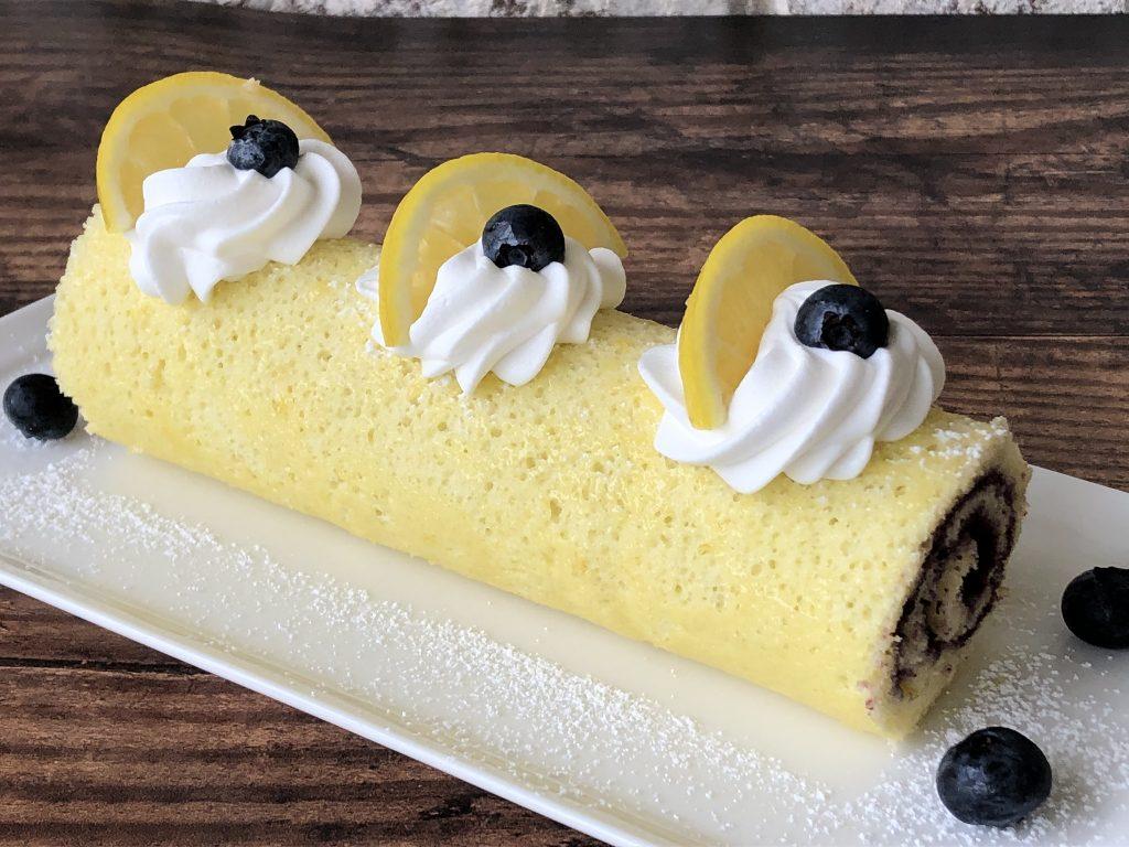 Blueberry Lemon Jellyroll cake presented on a platter