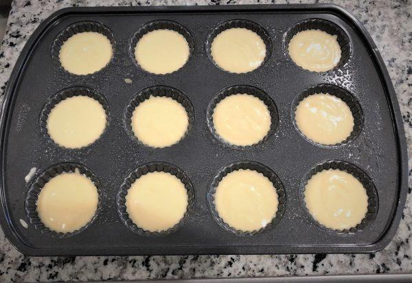 cupcake batter in a mini tart pan