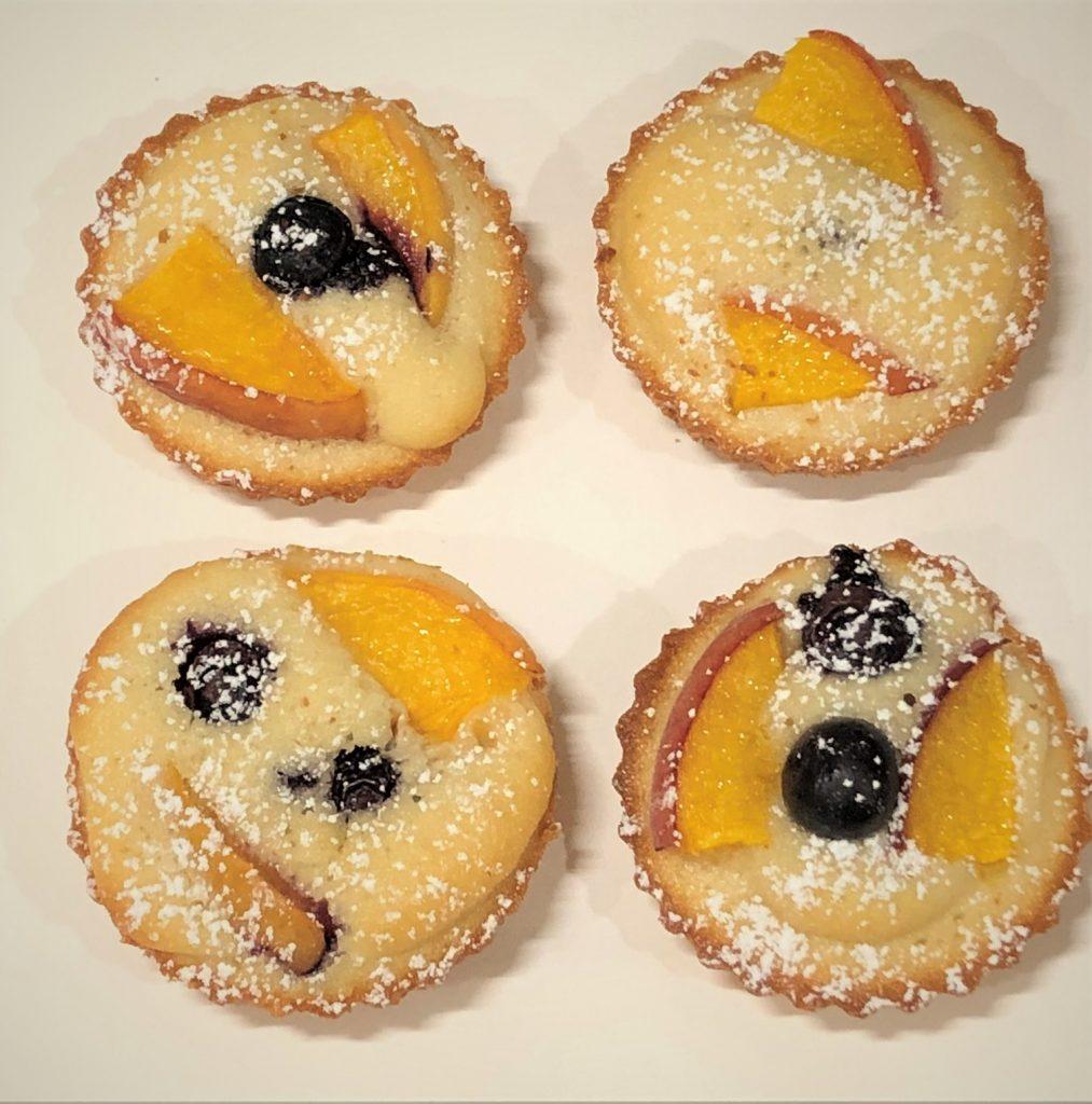 4 peach blueberry tea cakes on a plate
