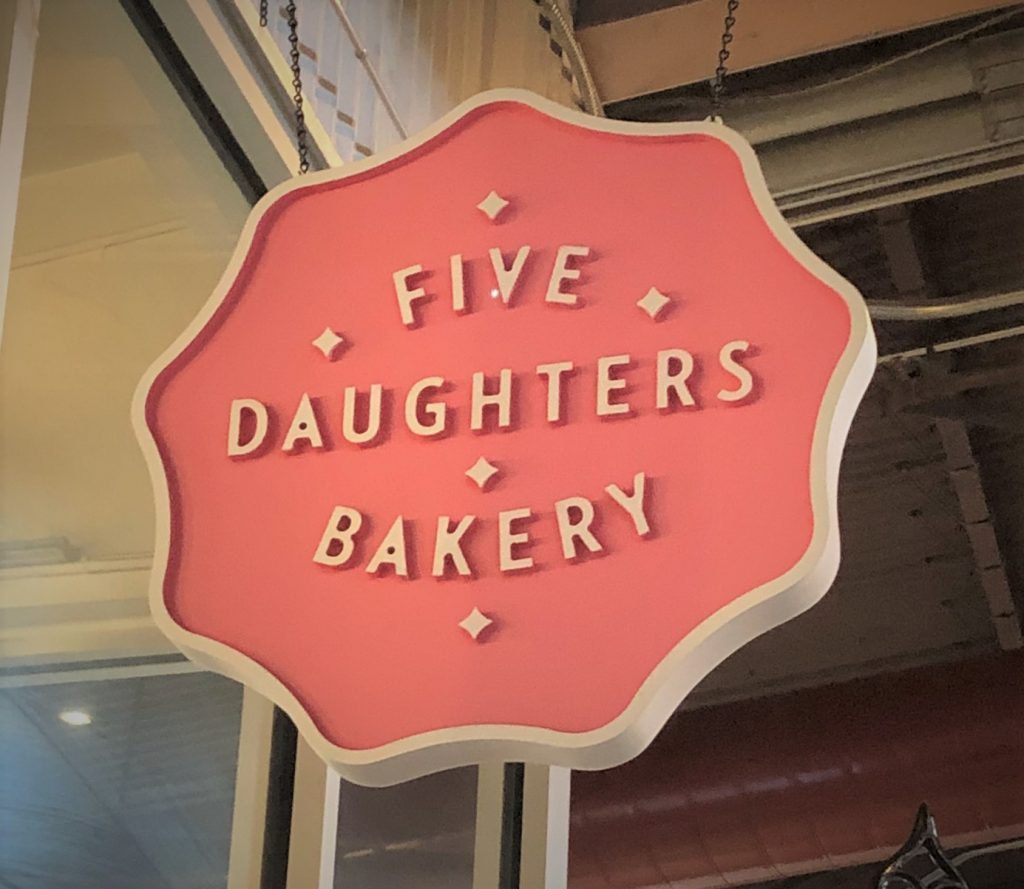 5 daughters bakery pink sign