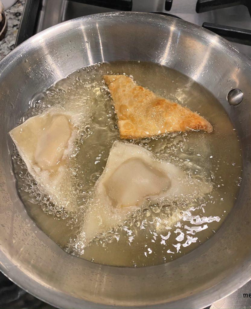 fying wontons in a saucepan