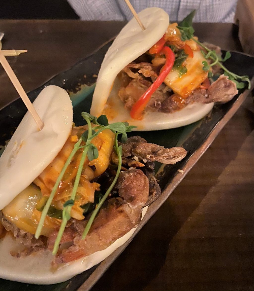 asian bun tacos on a plate