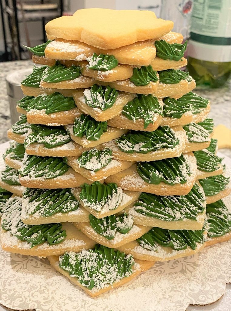 Stacking star sugar cookies to make a tree