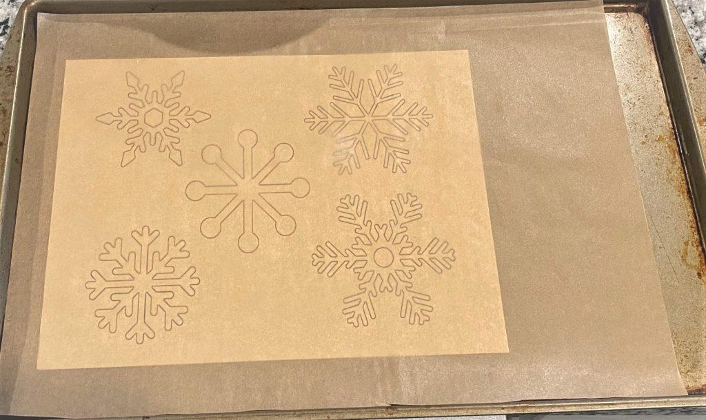snowflake template on a sheet pan