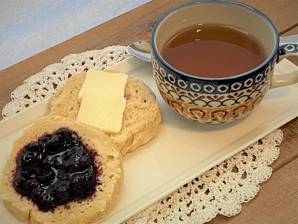 tea and english muffins on a plate