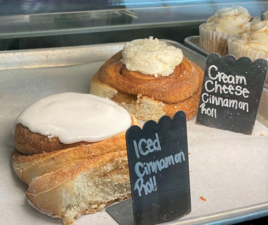 cinnamon rolls in bakery case